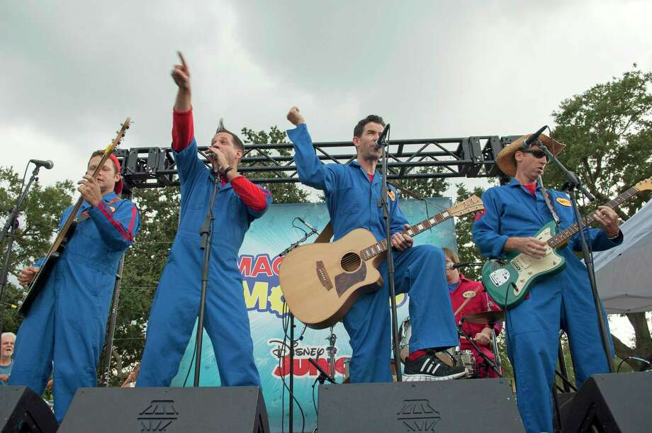 "From left, Dave Poche, Scott Durban, Rich Collins and Scott ""Smitty"" Smith of the New Orleans band Imagination Movers, performs at an outdoor event in 2013. Photo: Scott Saltzman /Disney Junior / Getty Images / 2013 Disney Enterprises, Inc."