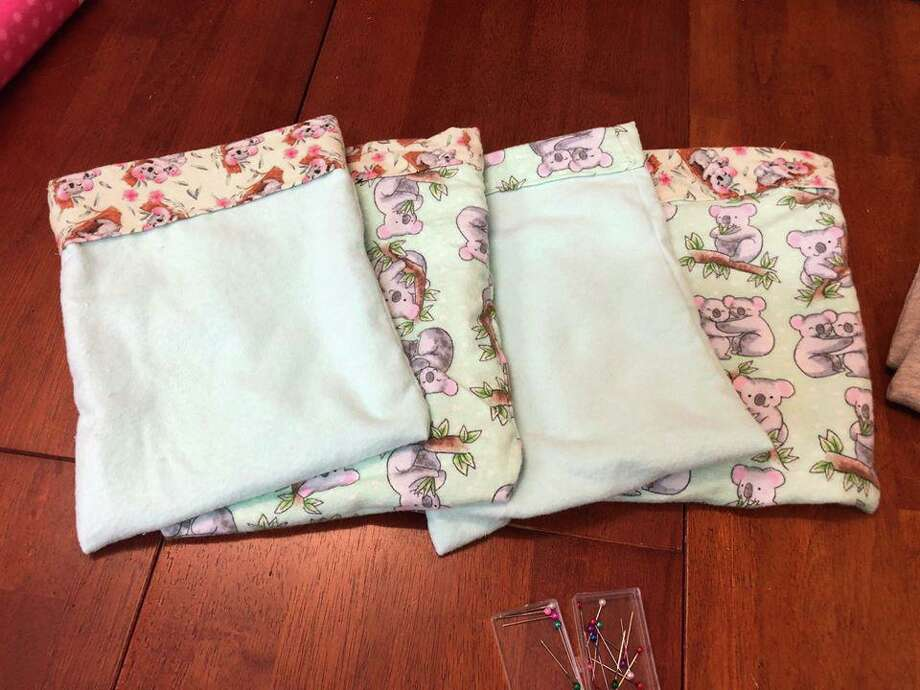 Joey pouches, handmade by a group of fiber artists at In Sheep's Clothing last weekend, will be sent to animal rescue groups in Australia. Photo: Ginger Balch / Contributed Photo