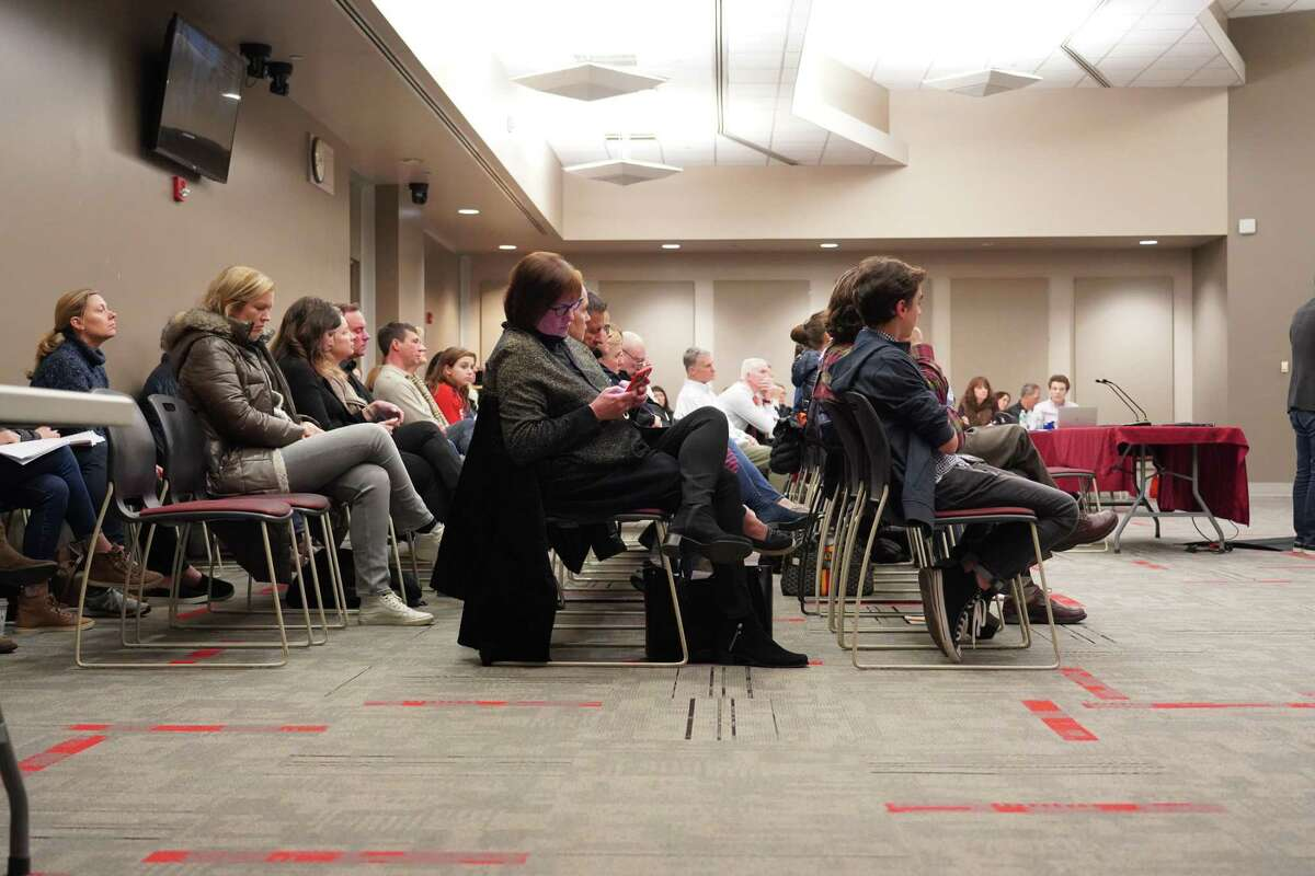 People were left standing when 32 residents spoke at a public hearing in the meeting room at New Canaan High School to address the Board of Education on the proposed later start times on Jan. 13, 2020. Jane Woodie and Ken Lin opposed the plans.