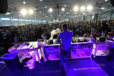 A large crowd watches a cooking demo last year at the Expo Center.