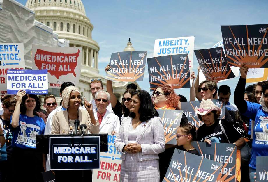 U.S. Reps. Ilhan Omar, left, and Pramila Jayapal speak in support of the Medicare for All Act of 2019 outside the House in June. A reader makes the point that the cost of not having health care may be someone's life. Photo: T.J. Kirkpatrick /New York Times / NYTNS