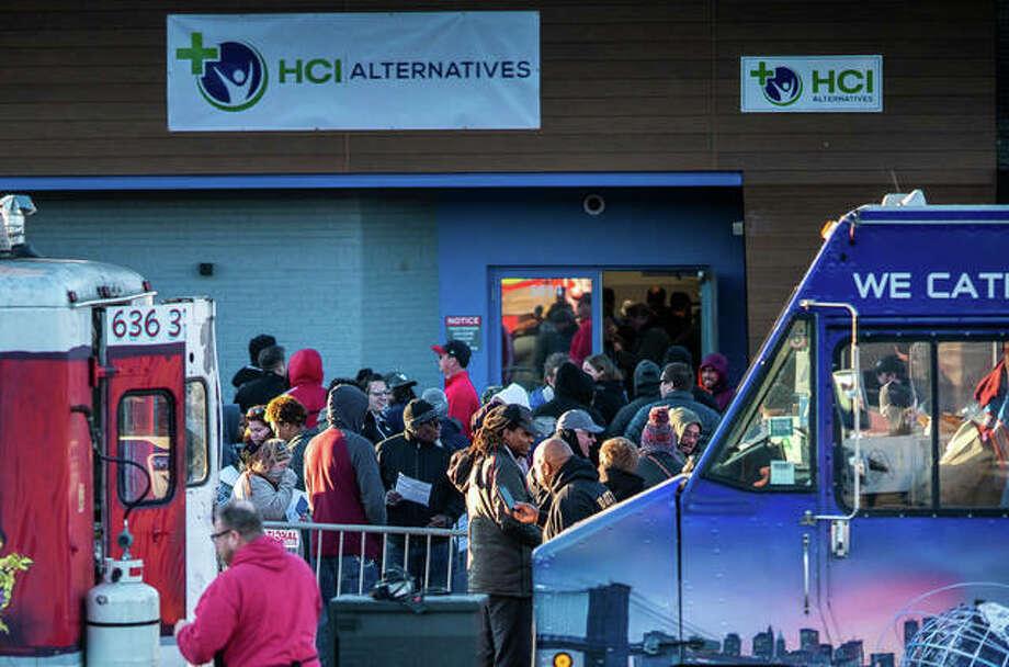 Hundreds wait in line outside HCI Alternatives in Collinsville on Jan. 1, 2020. Photo: Nathan Woodside | Telegraph File Photo