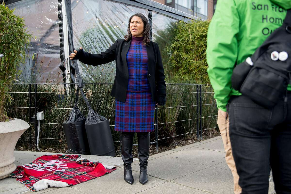 San Francisco Mayor London Breed walks along the Embarcadero with members of the San Francisco Homeless Outreach Team to identify possible candidates for the new Embarcadero Navigation Center in San Francisco, Calif. Tuesday, Jan. 14, 2020.