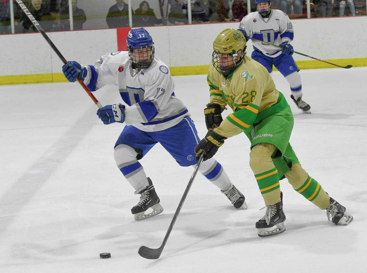 Notre Dame-West Haven Ryan Ahern (28) drives up the ice against Darien in the first period of a CIAC boys hockey match up at the Darien Ice House in Darien, Conn. on Jan. 11, 2020. Darien won 5-2.