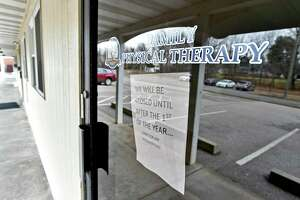 "Colchester, Connecticut - Tuesday, January 14, 2020: A sign in a door of Family Physical Therapy in the small complex of 7 Park Ave. in Colchester owned by Anthony Todt, who may be connected to the 4 people found dead in Celebration, Florida, according to officials. The sign reads ""We will closed until after the 1st of the year…Sorry for any inconvenience."" Officials in the southeastern town of Colchester are asking residents to come together after a missing local family was linked to the discovery of the bodies in Celebration, Florida. Anthony Todt, 44, and his wife Megan, 42, have not been in contact with family since Jan. 6, according to several news reports."