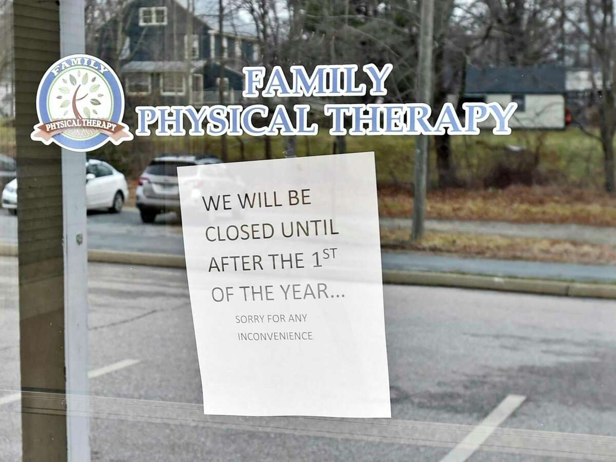 Colchester, Connecticut - Tuesday, January 14, 2020: A sign in a door of Family Physical Therapy in the small complex of 7 Park Ave. in Colchester owned by Anthony Todt, who may be connected to the 4 people found dead in Celebration, Florida, according to officials. The sign reads