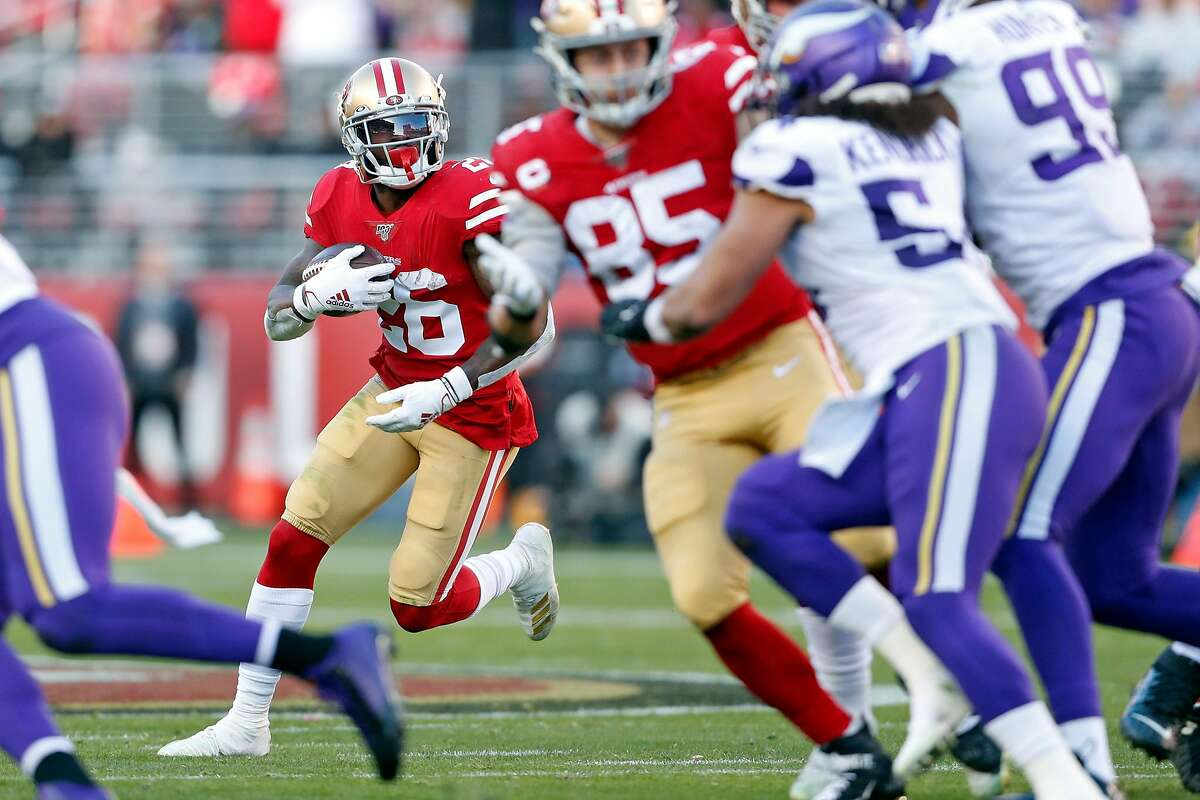 San Francisco 49ers' Tevin Coleman rushes in 3rd quarter of Niners' 27-10 win over Minnesota Vikings in NFC Divisional playoff game at Levi's Stadium in Santa Clara, Calif., on Saturday, January 11, 2020.