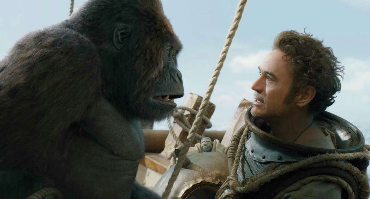 """This image released by Universal Pictures shows Chee-Chee, voiced by Rami Malek, left, and Dr. John Dolittle, portrayed by Robert Downey Jr. in a scene from """"Dolittle."""" (Universal Pictures via AP)"""