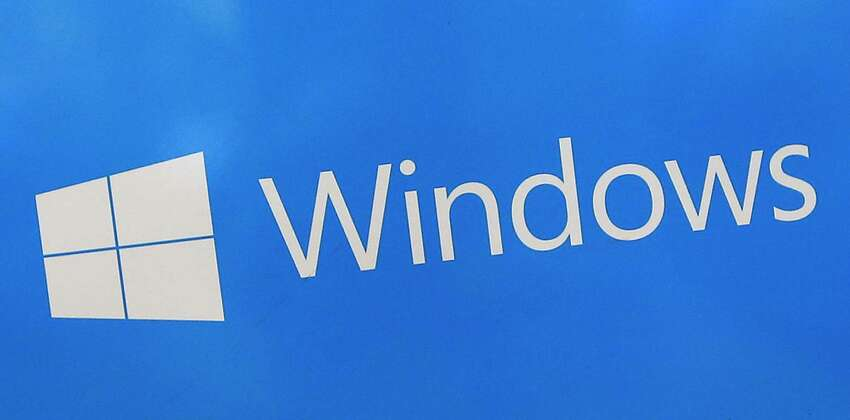 FILE - This Aug. 7, 2017, file shows a Microsoft Widows sign on display at a store in Hialeah, Fla. The National Security Agency has discovered a major security flaw in Microsoft's Windows operating system. Microsoft says the NSA notified the company about it. A fix was made available Tuesday, Jan. 14, 2020. (AP Photo/Alan Diaz)