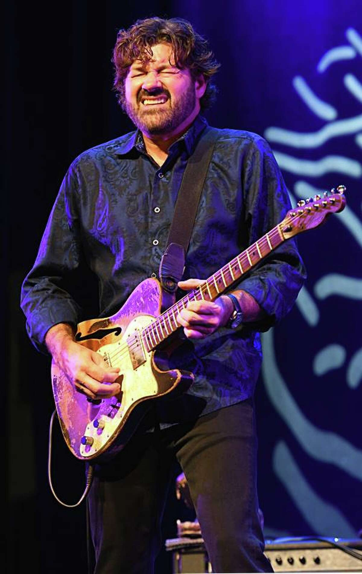Blues guitarist, musician, and singer Tab Benoit is shown performingto a sold out crowd at the Katharine Hepburn Cultural Arts center in Old Saybrook Jan. 8. His awesome guitar playing combines a number of blues styles, primarily Delta Blues. In 2003, he formed