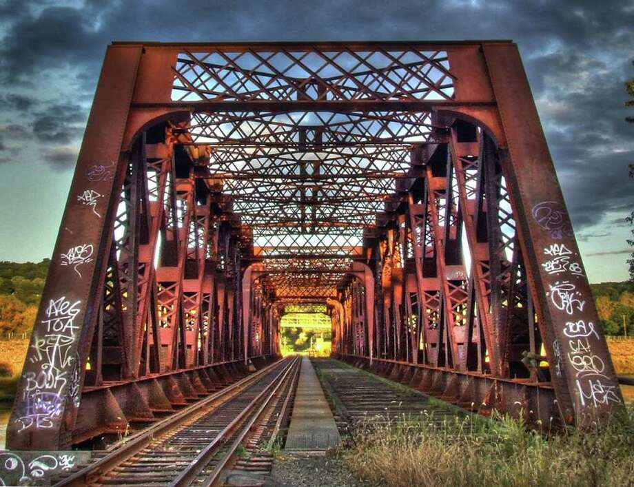 """Trainbridge,"" an artistic print of the bridge crossing the Housatonic River, is an example of the high dynamic range photography employed by Seymour design firm 203Communications for its customers. Photo: Contributed Photo / Connecticut Post Contributed"