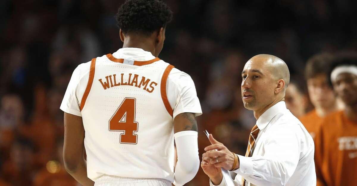 Texas head coach Shaka Smart talks with Texas guard Donovan Williams (4) as Texas plays Texas A&M during the second half of an NCAA college basketball game, Sunday, Dec. 8, 2019, in Fort Worth, Texas. Texas won 60-50. (AP Photo/Ron Jenkins)