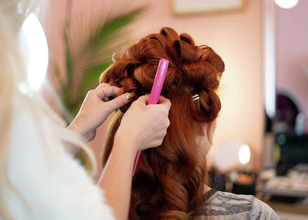 #74. Hairdressers, hairstylists, and cosmetologists - Annual mean wage: $30,190 (41.9% below mean for all occupations) - Median hourly wage: $11.89 - Number employed: 377,210 This occupation helps people look their best through hair and makeup services. No matter which state they work in, hairstylists and cosmetologists need to obtain a license, which usually requires over 1,000 hours of training. Starting salaries are low, but workers can boost their pay through tips for good service and beating out the competition for a coveted position at a high-paying salon. This slideshow was first published on theStacker.com