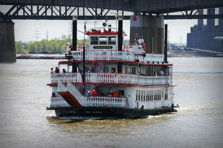 The Riverboats at the Gateway Arch's Tom Sawyer navigates the Mississippi River during a passenger excursion. The riverboats also include the Becky Thatcher.