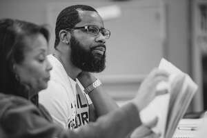 """Michele Harrell, left, and Kedrick Brown read through lines for the AD Players production of """"Guess Who's Coming to Dinner."""" The show is slated to run Friday, Jan. 31, through Sunday, Feb. 16."""