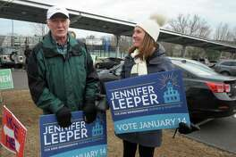 Democrat Jennifer Leeper greets voters outside Fairfield Ludlowe High School, in Fairfield, Conn. Jan. 14, 2020. Leeper is a candidate for the 132nd House of Representatives seat.