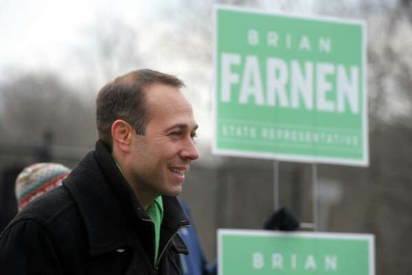 Republican Brian Farnen greets voters outside Mill Hill Elementary School, in Fairfield, Conn. Jan. 14, 2020. Farnen is a candidate for the 132nd House of Representatives seat.