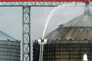 Firefighters spray water on a silo to cool 10,000 tons of smoldering wood pellets at the Port of Port Arthur on Monday. According to city spokeswoman Risa Carpenter, hot spots located by officials Saturday evening ignited early Sunday due to a temperature spike. City firefighters extinguished the flames and began cooling the structure. Port of Port Arthur Director Floyd Gaspard said the fire was started by Òinternal combustion.Ó The pellets originated from the German Pellets facility in Woodville, where a fire occurred in April of 2014.  On Feb. 27, a conveyor belt loading a ship at the Port of Port Arthur with several tons of wood pellets caught fire, setting the wood ablaze and sending a colossal cloud of black smoke into the air. Photo taken Monday, April 17, 2017 Guiseppe Barranco/The Enterprise