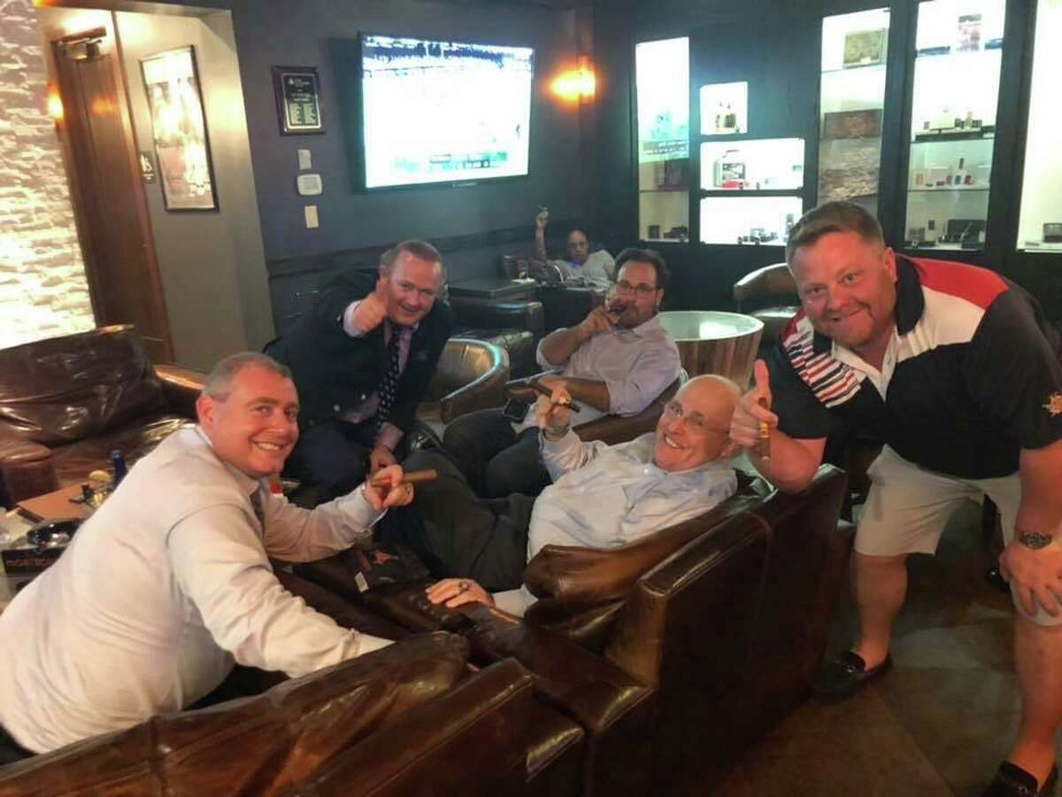 Robert Hyde, right, a Republican candidate for Congress in Connecticut's 5th District, smiles with Rudy Giuliani, center right, the president's personal lawyer, and Giuliani's indicted associates Igor Fruman, center left, and Lev Parnas, left.