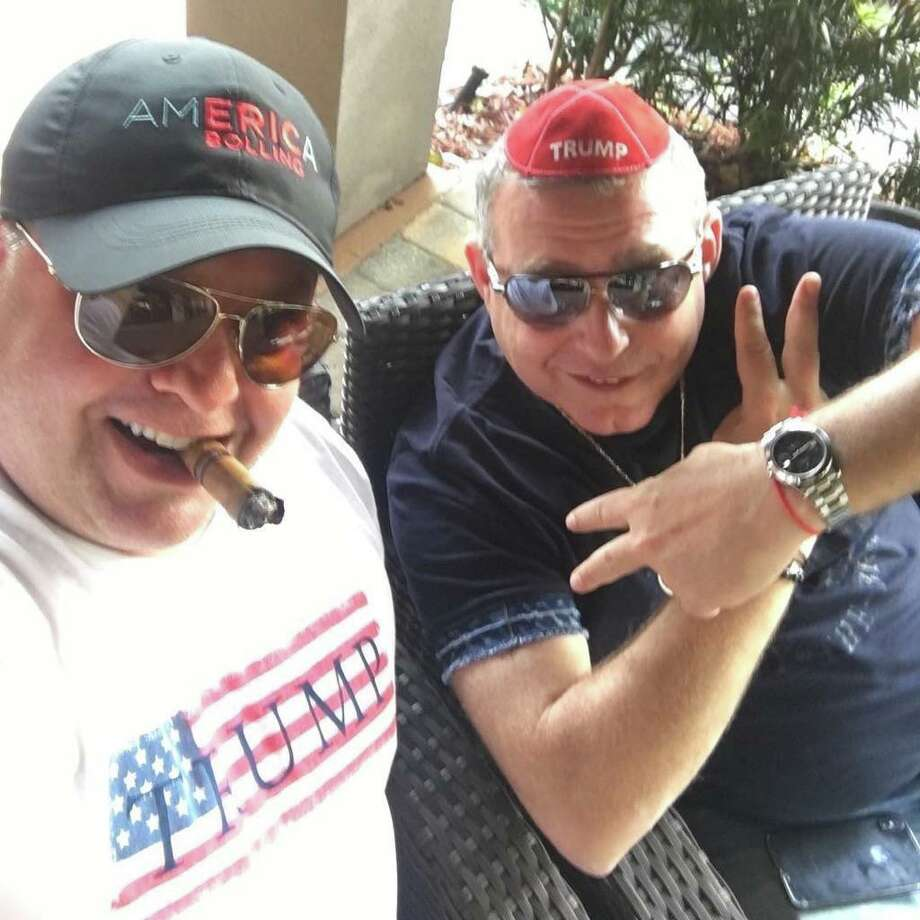 Robert Hyde (left), a Republican candidate for Congress in Connecticut's 5th District, smokes a cigar with Lev Parnas (right), Soviet-born businessman and associate of Rudy Giuliani indicted on campaign finance violations. Photo: Contributed