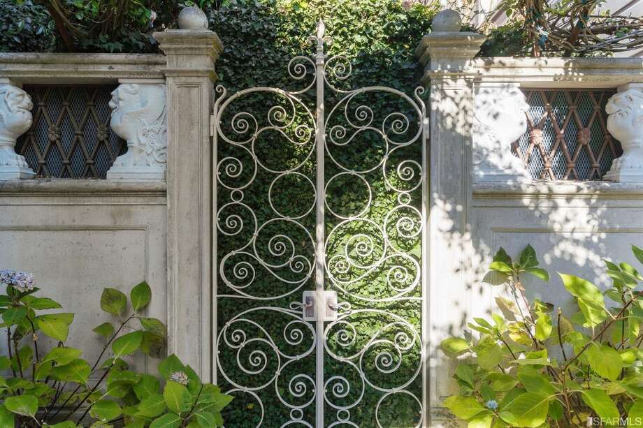 The Italianate-inspired garden was a labor of love for the long-time owners who put a lot of hands-on work into the space. Photo: Open Homes Photography
