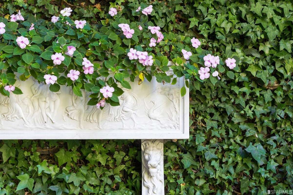 The Italianate-inspired garden was a labor of love for the long-time owners who put a lot of hands-on work into the space.
