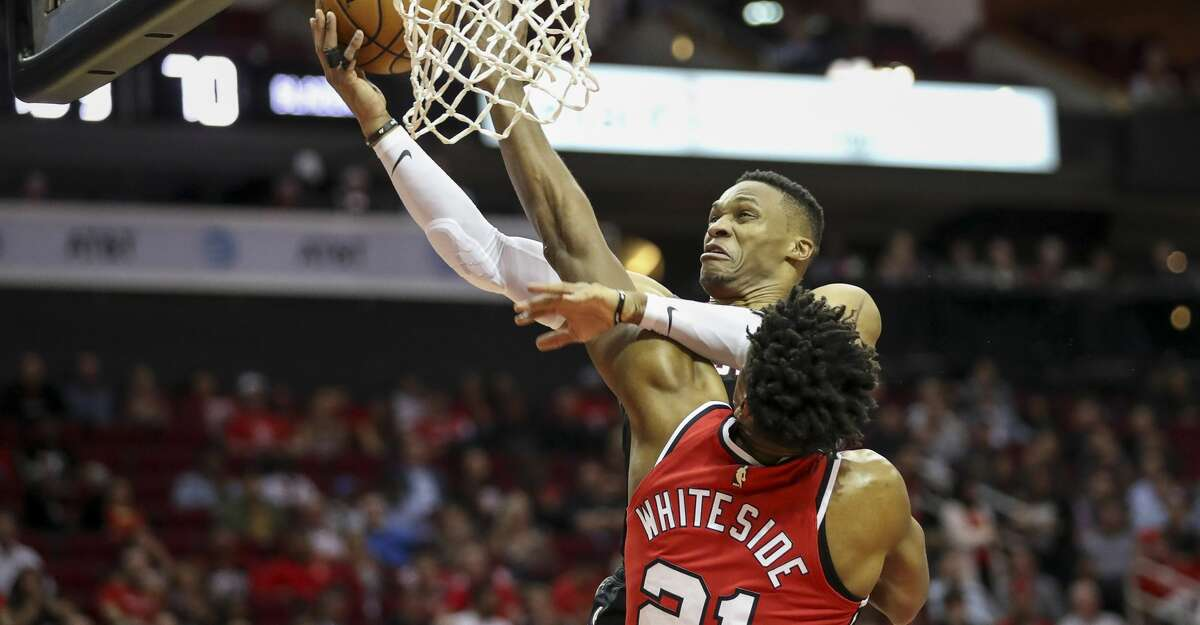 PHOTOS: Rockets game-by-game Houston Rockets guard Russell Westbrook (0) gets tangled up with Portland Trail Blazers center Hassan Whiteside (21) as he drives to the basket during the third quarter of an NBA basketball game at the Toyota Center on Monday, Nov. 18, 2019, in Houston. Browse through the photos to see how the Rockets have fared in each game this season.
