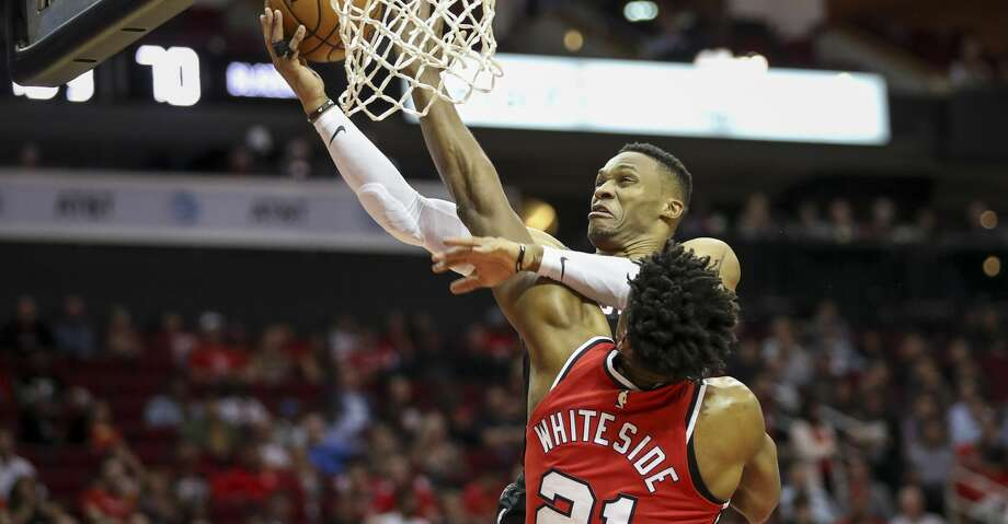 PHOTOS: Rockets game-by-game Houston Rockets guard Russell Westbrook (0) gets tangled up with Portland Trail Blazers center Hassan Whiteside (21) as he drives to the basket during the third quarter of an NBA basketball game at the Toyota Center on Monday, Nov. 18, 2019, in Houston. Browse through the photos to see how the Rockets have fared in each game this season. Photo: Jon Shapley/Staff Photographer