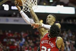 Houston Rockets guard Russell Westbrook (0) gets tangled up with Portland Trail Blazers center Hassan Whiteside (21) as he drives to the basket during the third quarter of an NBA basketball game at the Toyota Center on Monday, Nov. 18, 2019, in Houston.