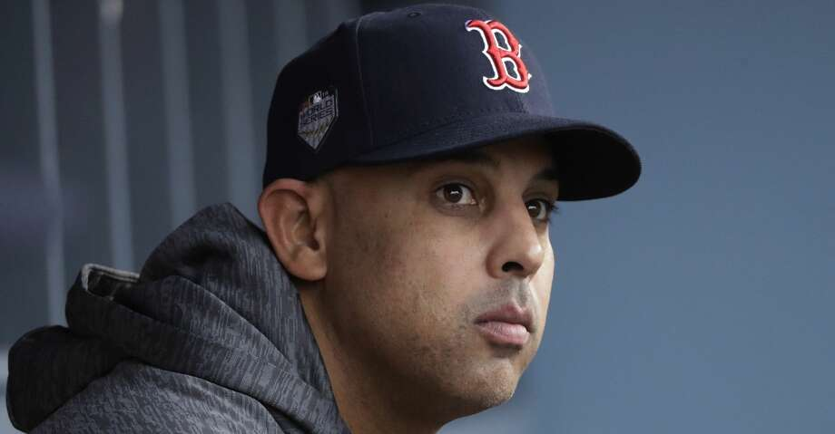 FILE - In this Oct. 28, 2018, file photo, Boston Red Sox manager Alex Cora waits for the start of Game 5 of the baseball World Series between the Red Sox and Los Angeles Dodgers in Los Angeles. Cora was fired by the Red Sox on Tuesday, Jan. 14, 2020, a day after baseball Commissioner Rob Manfred implicated him in the sport's sign-stealing scandal. (AP Photo/David J. Phillip, File) Photo: David J. Phillip/Associated Press