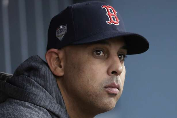 FILE - In this Oct. 28, 2018, file photo, Boston Red Sox manager Alex Cora waits for the start of Game 5 of the baseball World Series between the Red Sox and Los Angeles Dodgers in Los Angeles. Cora was fired by the Red Sox on Tuesday, Jan. 14, 2020, a day after baseball Commissioner Rob Manfred implicated him in the sport's sign-stealing scandal. (AP Photo/David J. Phillip, File)