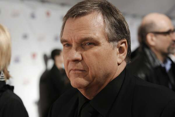 FILE - In this Feb. 6, 2009, file photo, singer Michael Lee Aday, who goes by the stage name Meat Loaf, arrives at the MusiCares Person of the Year tribute honoring Neil Diamond in Los Angeles. Meat Loaf has filed a lawsuit against a hotel at Dallas-Fort Worth International Airport and organizers of a horror convention held there, blaming them for negligence when he fell from a stage while answering questions from convention goers last May. He and his wife Deborah Lee Gillespie Aday filed the suit Monday, Jan. 13, 2020, in a state district court in Fort Worth, Texas, against the Hyatt Corp. and Texas Frightmare Weekend LLC. (AP Photo/Chris Pizzello, File)