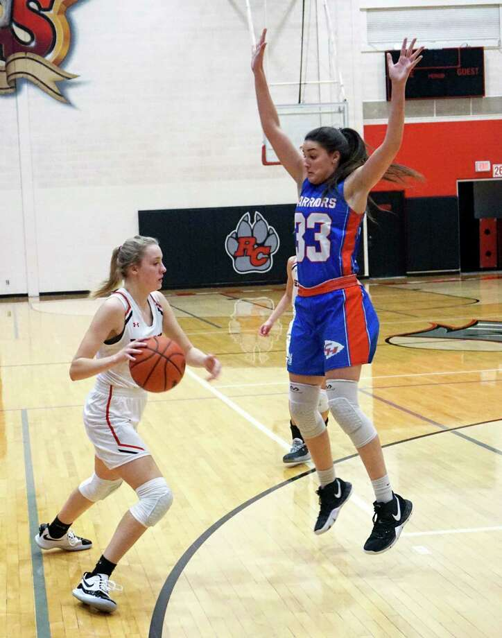 Reed City freshman Christina Malackanich looks to dribble past Chippewa Hills senior Taylor Need during RC's 71-40 victory on Tuesday night at Reed City High School. (Pioneer photo/Joe Judd)