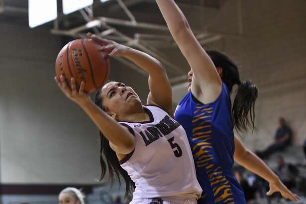 Lee's Salma Trejo (5) shoots the ball as Frenship's Zaria Fowler guards her Tuesday, Jan. 14, 2020 at Lee High School.