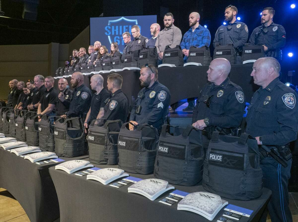 Midland police officers stand behind new vests 01/14/2020 during the Shield 616 vest presentation at Stonegate Fellowship. Shield 616 helps organizes and raise money in the community to purchase new ballistic vests for first responders. Tim Fischer/Reporter-Telegram