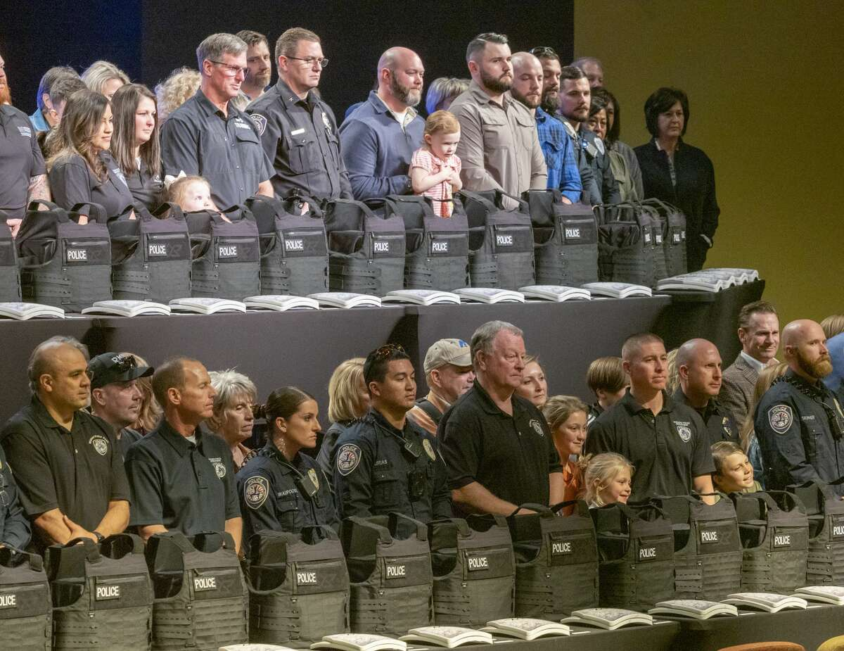 Midland police officers are joined by family and community members 01/14/2020 during the Shield 616 vest presentation at Stonegate Fellowship. Shield 616 helps organizes and raise money in the community to purchase new ballistic vests for first responders. Tim Fischer/Reporter-Telegram