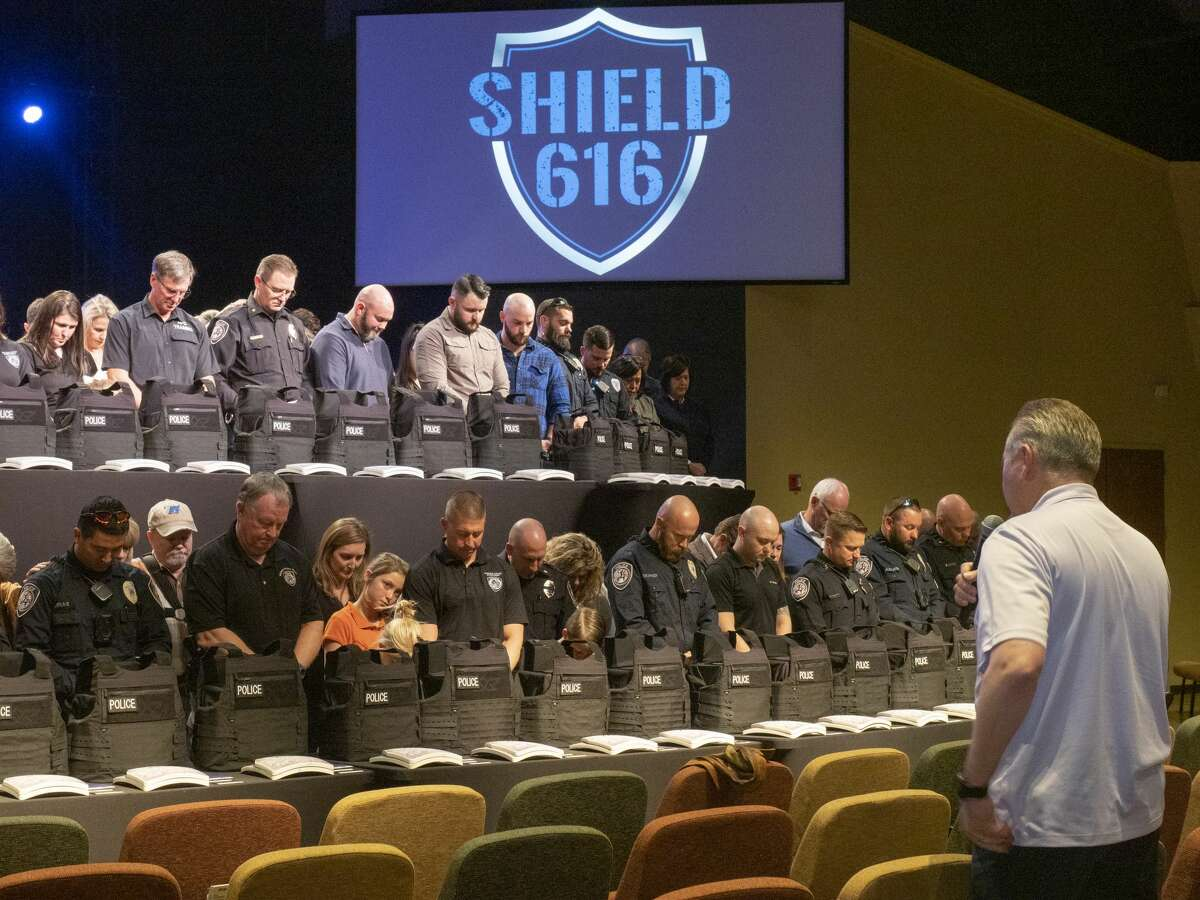 Stonegate Fellowship Executive Pastor Larry Gilbert says a prayer over the officers and their families 01/14/2020 during the Shield 616 vest presentation at Stonegate. Tim Fischer/Reporter-Telegram