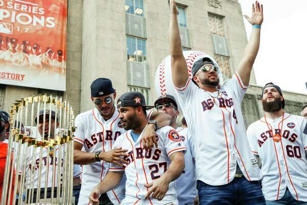 Houston Astros players celebrate their 2017 World Series championship, but there will always be an asterisk by this moment.