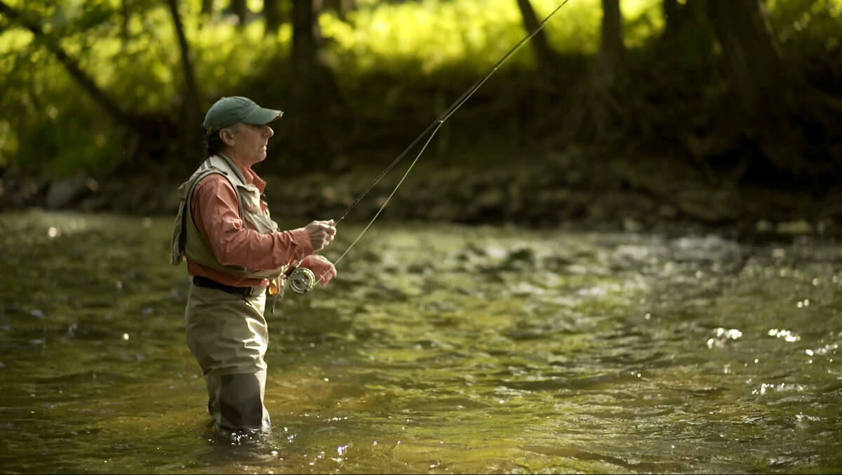 Artists Adriano Manocchia is inspired to paint by fly-fishing on the Battenkill River.