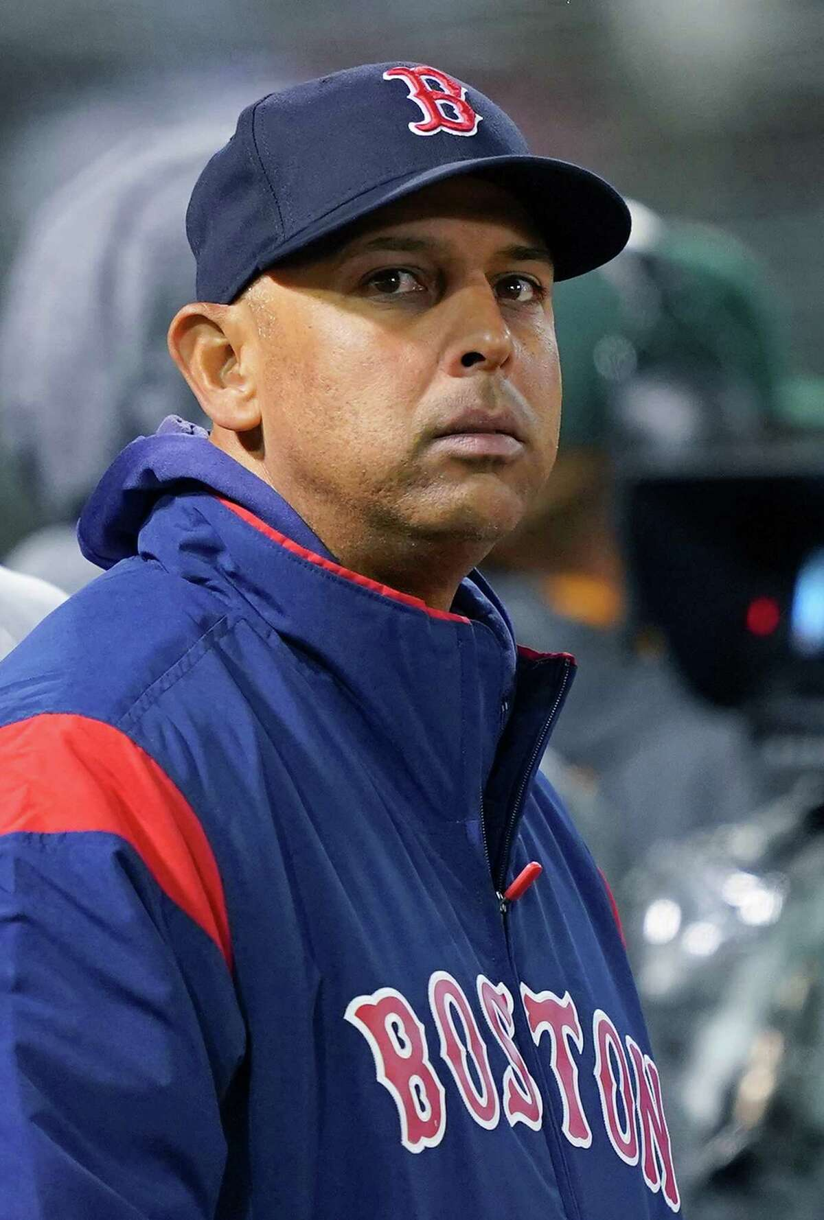 OAKLAND, CA - APRIL 01: Manager Alex Cora #20 of the Boston Red Sox looks on from the end of the dugout against the Oakland Athletics in the top of the fifth inning at Oakland-Alameda County Coliseum on April 1, 2019 in Oakland, California. (Photo by Thearon W. Henderson/Getty Images)