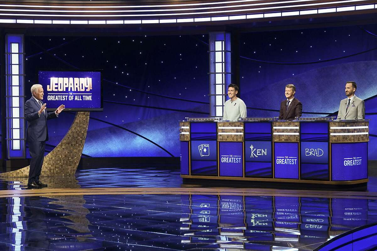 """In this image released by ABC, host Alex Trebec, left, appear with contestants, James Holzhauer, center, Ken Jennings and Brad Rutter, right, on the set of """"Jeopardy! The Greatest of All Time,"""" in Los Angeles. The all-time top """"Jeopardy!"""" money winners; Rutter, Jennings and Holzhauer, will compete in a rare prime-time edition of the TV quiz show which will air on consecutive nights beginning 8 p.m. EDT Tuesday. (Eric McCandless/ABC via AP)"""