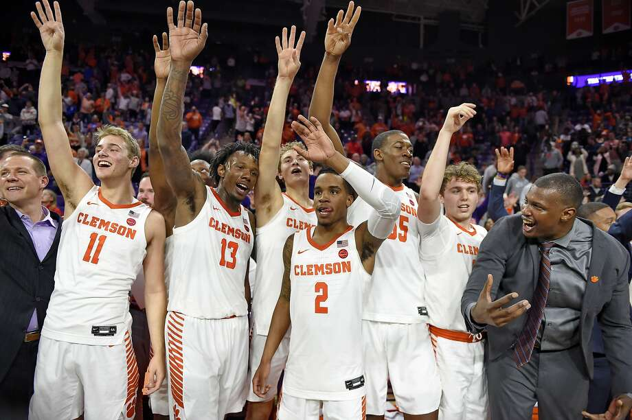 Clemson players, including Parker Fox (11), the son of Cal head coach Mark Fox, salute their fans after upsetting third-ranked Duke. The Tigers won for the first time ever in Chapel Hill, N.C., on Saturday. Photo: Richard Shiro / Associated Press