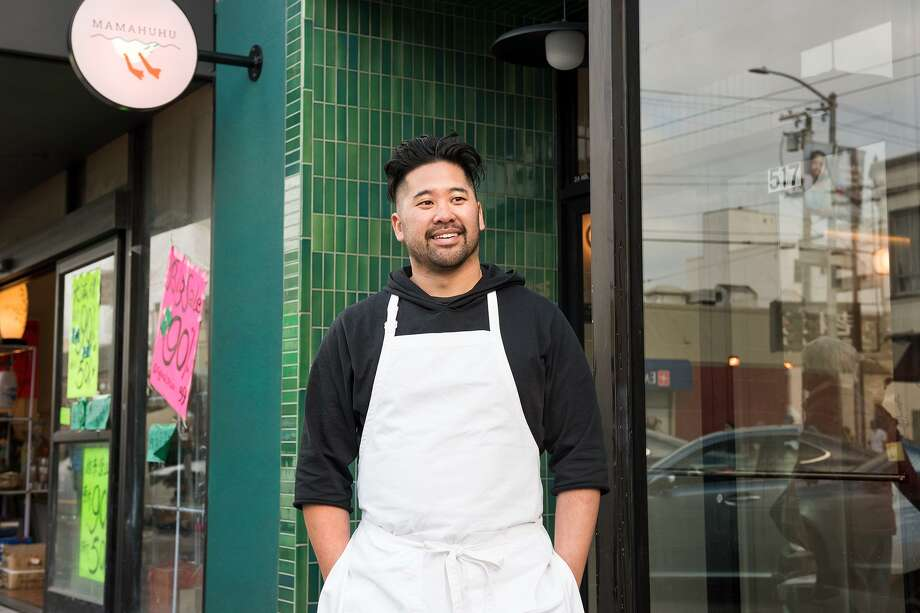 Chef Brandon Jew stands outside his restaurant, Mamahuhu, at 517 Clement Street in San Francisco's Inner Richmond neighborhood. Rupert Blease, chef and co-owner of Lord Stanley, and Jew, chef-owner of Mister Jiu's, have collaborated to bring Lord Jiu's: a pop-up where customers can order a five-course meal for pickup from March 23-27. Photo: Blair Heagerty / SFGate