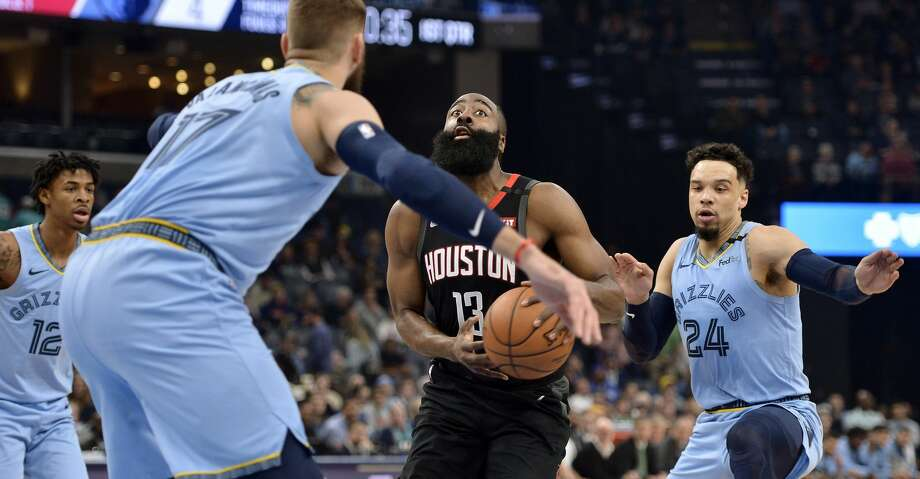 Houston Rockets guard James Harden (13) drives between Memphis Grizzlies center Jonas Valanciunas (17) and guards Ja Morant (12) and Dillon Brooks (24) during the first half of an NBA basketball game Tuesday, Jan. 14, 2020, in Memphis, Tenn. (AP Photo/Brandon Dill) Photo: Brandon Dill/Associated Press