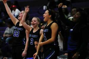 New Caney players react after a 3-pointer by power forward Tori Garza during the third quarter of a District 20-5A high school basketball game at Willis High School, Tuesday, Jan. 14, 2020, in Willis.