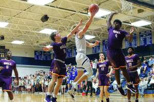 Friendswood's Hudson Bockart (3) tries to lay up a shot over Galveston Ball's Trevon Turner (4) Tuesday at Friendswood High School.