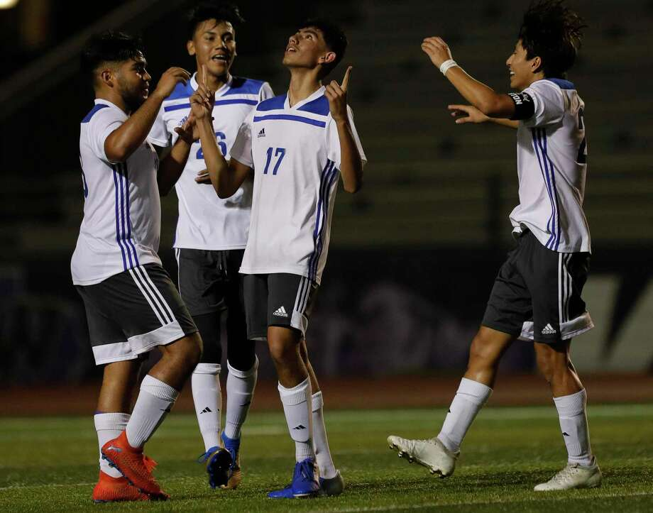 New Caney's Miguel Rodriguez (17) reacts after scoring a goal on a free kick during the first period of a District 20-5A high school soccer match at Berton A. Yates Stadium, Tuesday, Jan. 14, 2020, in Willis. Photo: Jason Fochtman, Houston Chronicle / Staff Photographer / Houston Chronicle © 2020