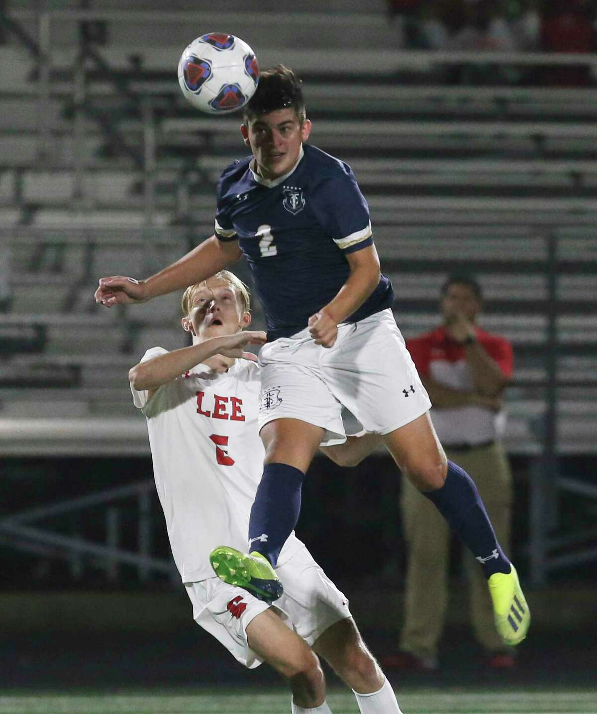 Central Catholic's Erik Alvarado (02) gets up to head the ball against LEE's Andrew Erickson (06) in boys soccer at Central Catholic on Tuesday, Jan. 14, 2020. LEE defeated Central Catholic, 1-0, to take the win between the two top rated high school teams.