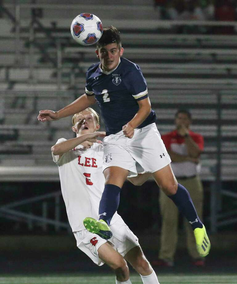 Central Catholic's Erik Alvarado (02) gets up to head the ball against LEE's Andrew Erickson (06) in boys soccer at Central Catholic on Tuesday, Jan. 14, 2020. LEE defeated Central Catholic, 1-0, to take the win between the two top rated high school teams. Photo: Kin Man Hui, San Antonio Express-News / Staff Photographer / **MANDATORY CREDIT FOR PHOTOGRAPHER AND SAN ANTONIO EXPRESS-NEWS/NO SALES/MAGS OUT/ TV OUT