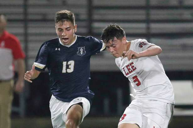 LEE's Hugo Cerros (03) gets the pass against Central Catholic's Jacob Jones (13) in boys soccer at Central Catholic on Tuesday, Jan. 14, 2020. LEE defeated Central Catholic, 1-0, to take the win between the two top rated high school teams.